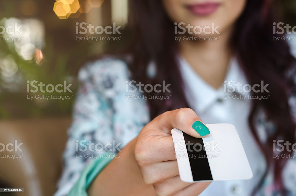 Young woman paying  bill with a credit card. stock photo