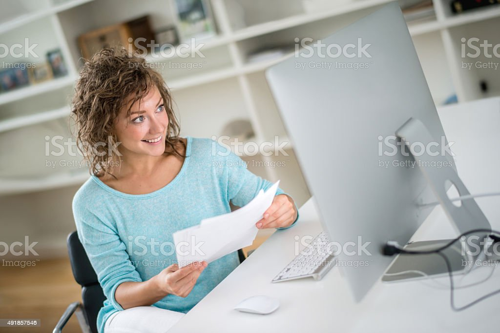 Young woman paying bills online stock photo
