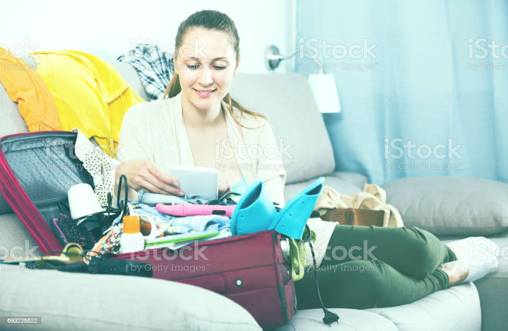 Young woman paying by credit card in internet store stock photo