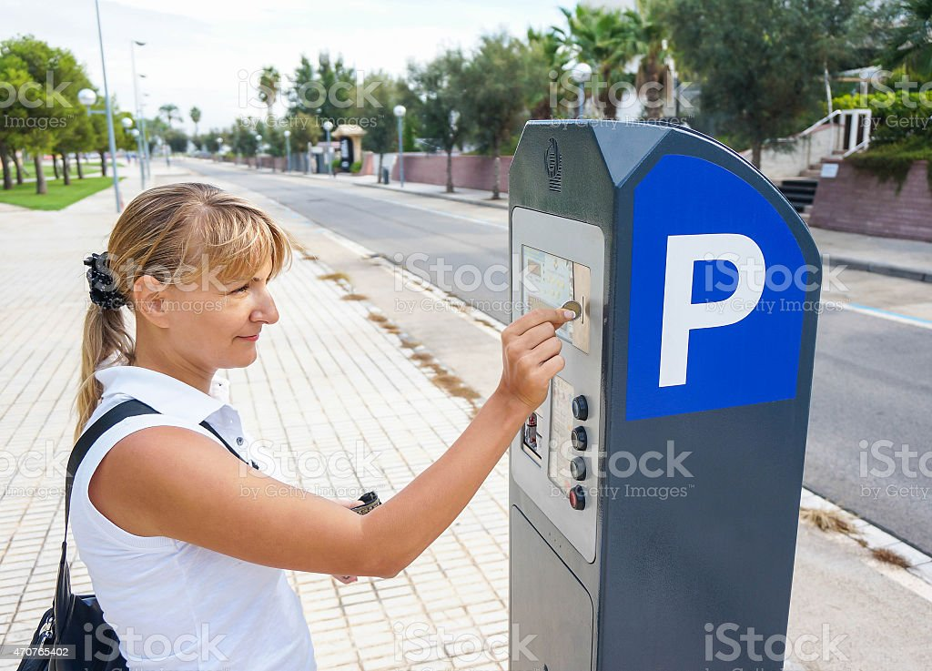 young woman paying for parking stock photo