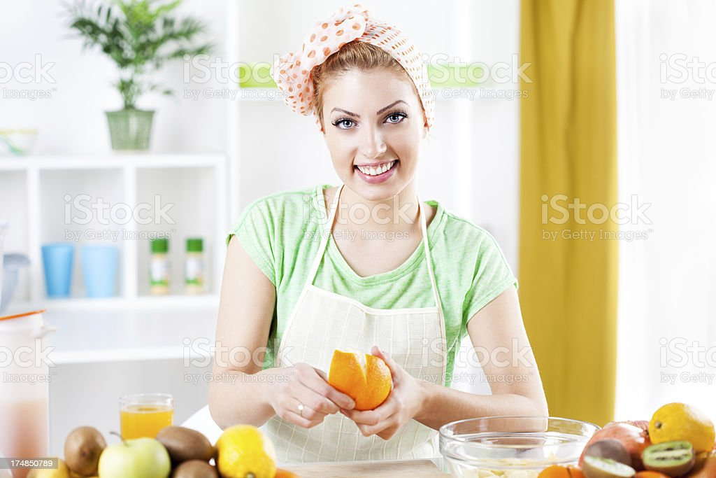 Young woman peeling oranges. royalty-free stock photo