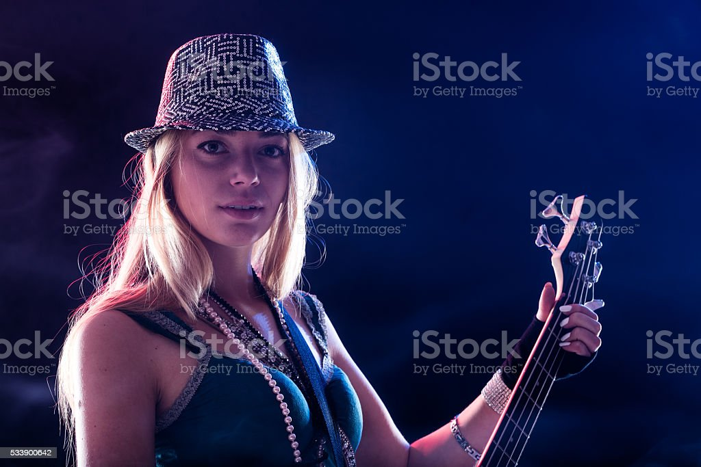 young woman performing live as guitar player stock photo