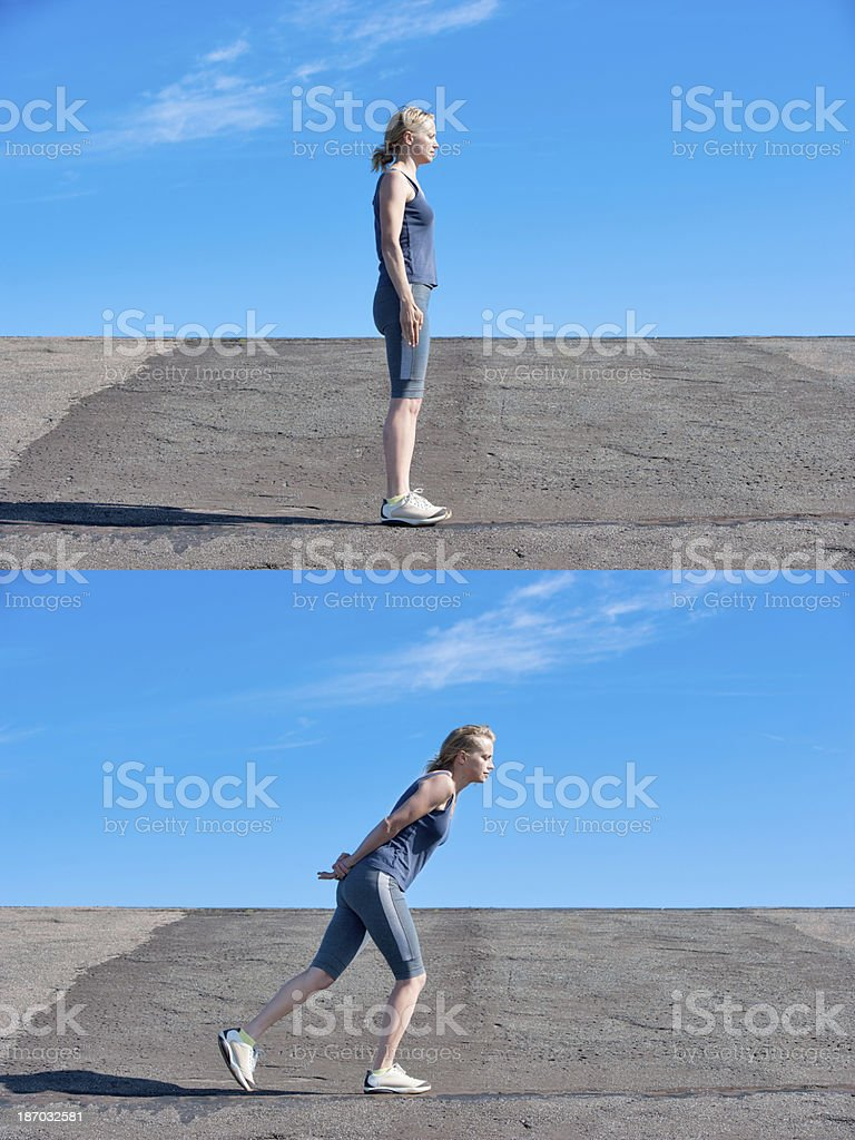 Young woman performing small lunge stock photo