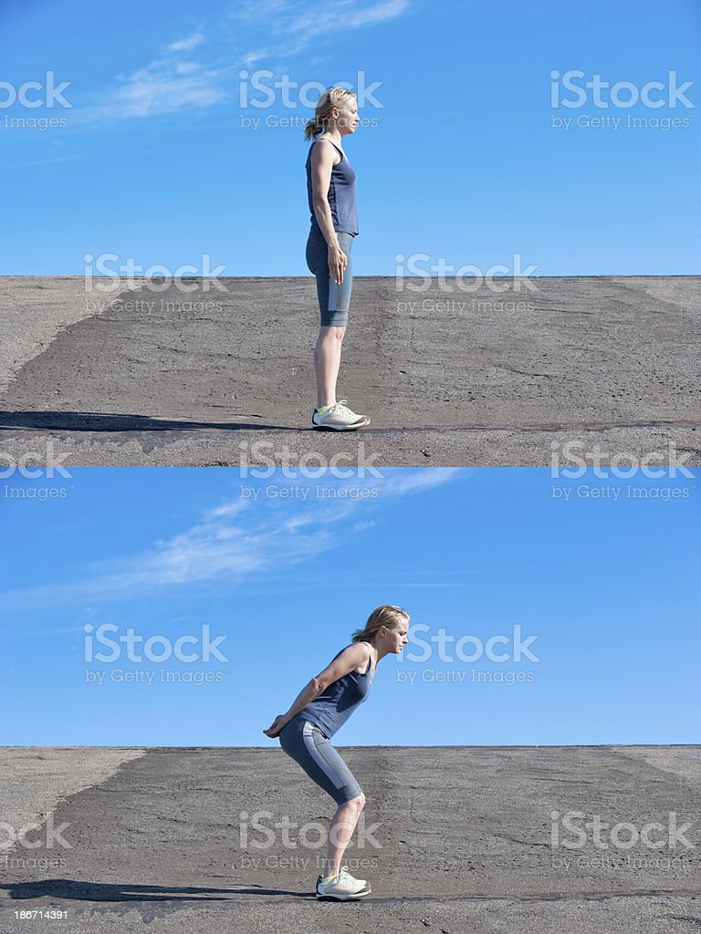 Young woman performing squat stock photo