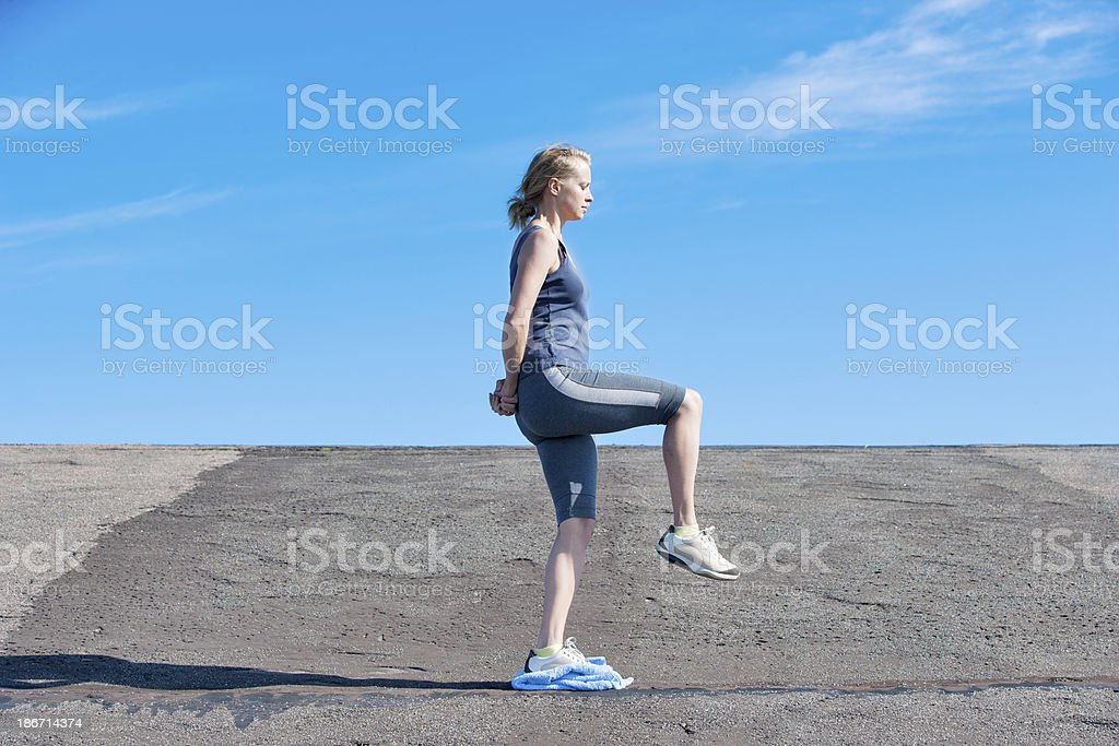 Young woman performing stabilizing exercise royalty-free stock photo