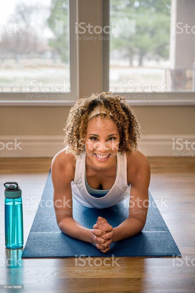 Young Woman Performing Yoga Plank stock photo