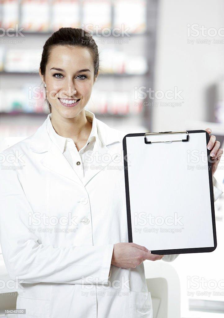 Jeune femme Pharmacien photo libre de droits