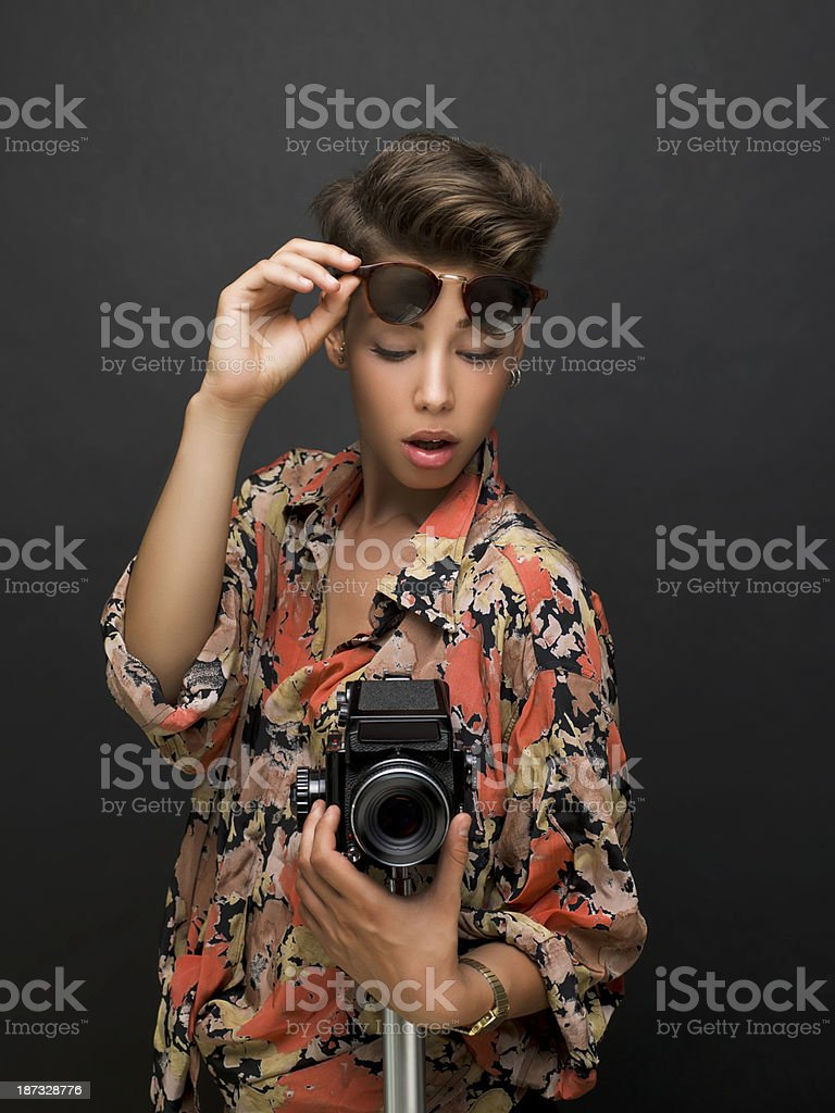 Young woman photographer stock photo