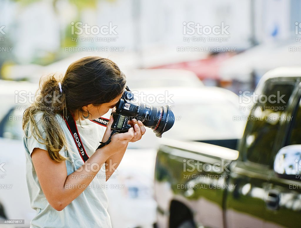 Young Woman Photographing Outdoor With Canon EOS 7D stock photo