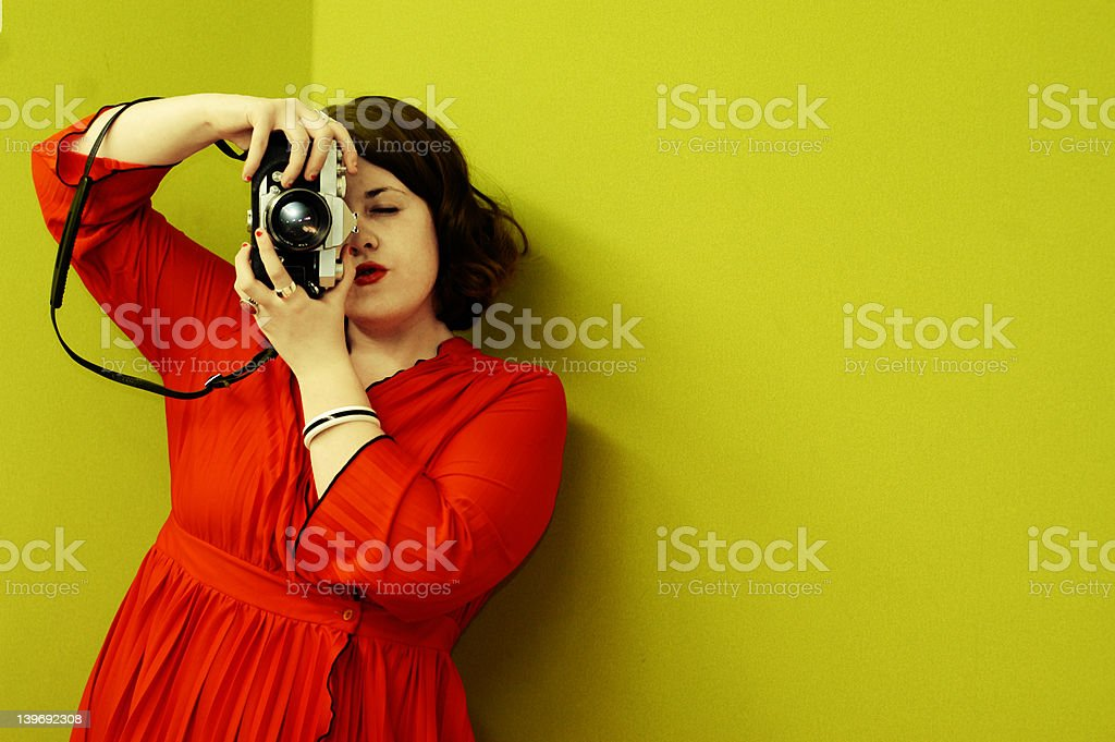 Young Woman Photographing with Vintage Film Camera stock photo