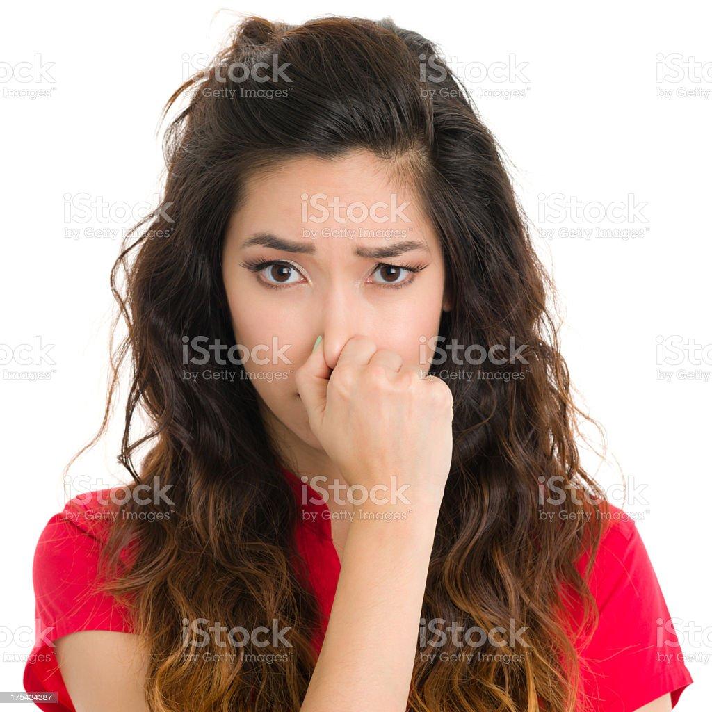 Young Woman Pinching Nose stock photo