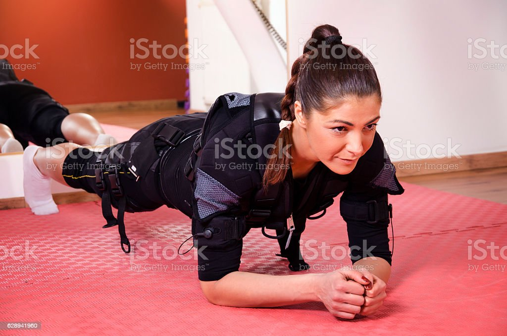 Young woman plank exercise stock photo