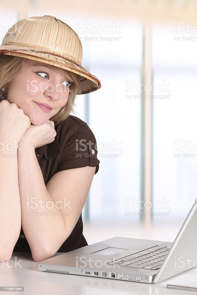 Young woman planning holiday via internet royalty-free stock photo