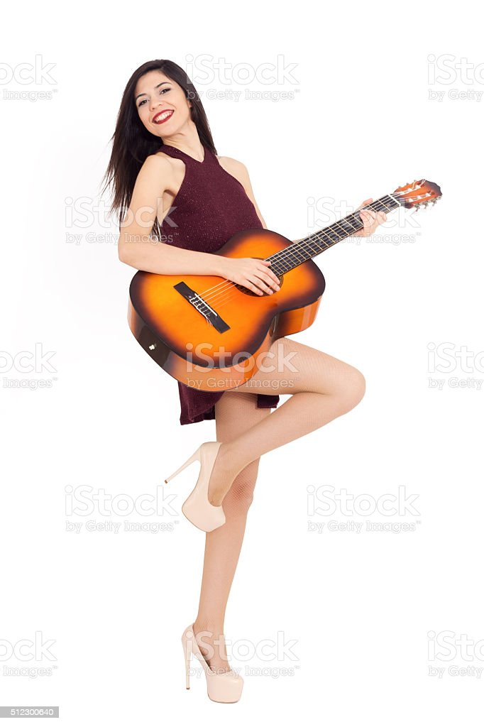 Young woman play guitar stock photo