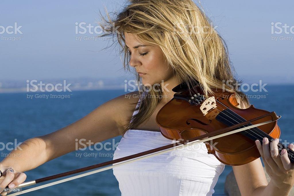 young woman play violin royalty-free stock photo