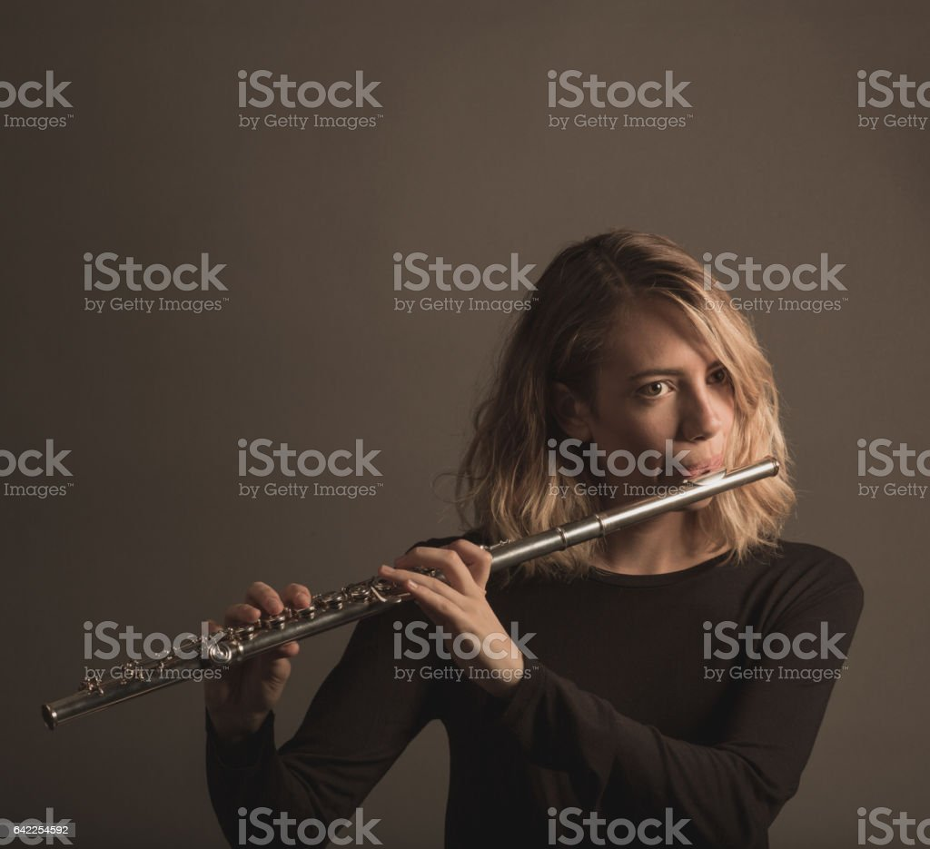Young Woman Playing a Flute stock photo