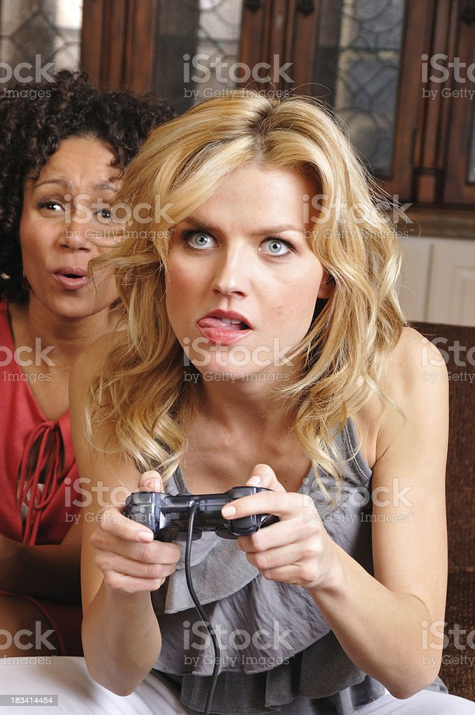 Young Woman Playing a Video Game stock photo