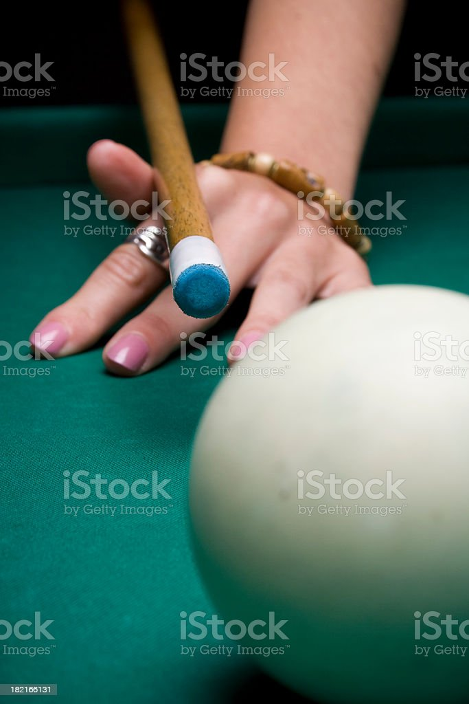 Young woman playing billiar royalty-free stock photo