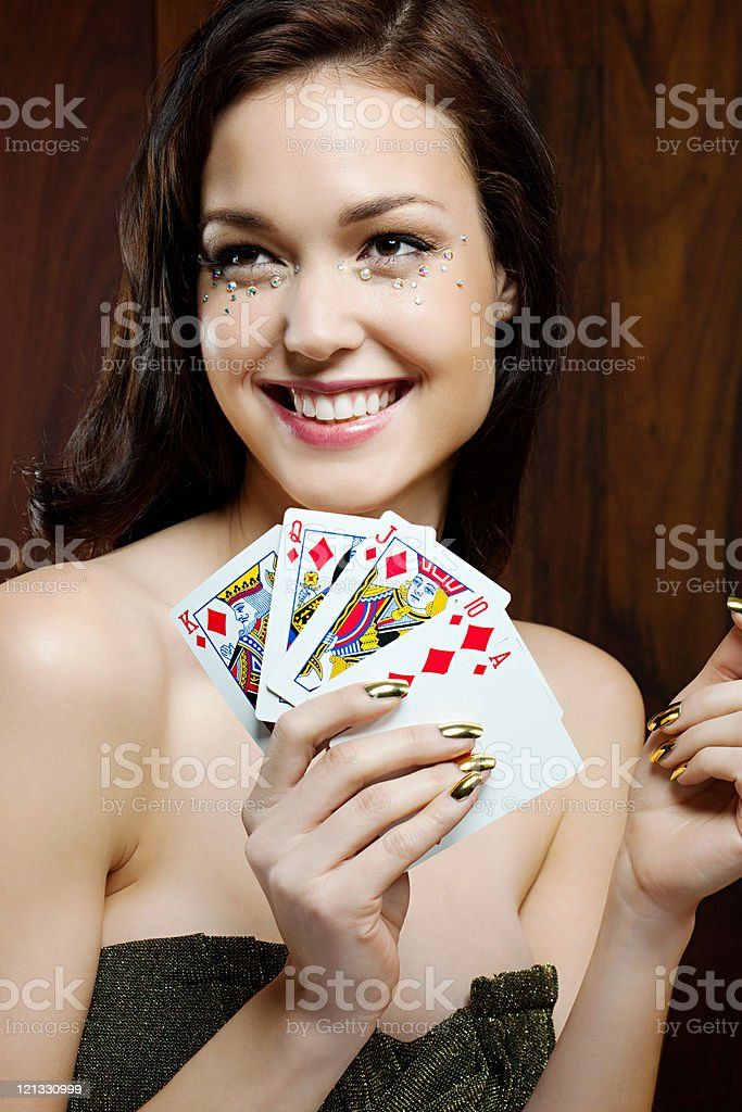 Young woman playing cards stock photo