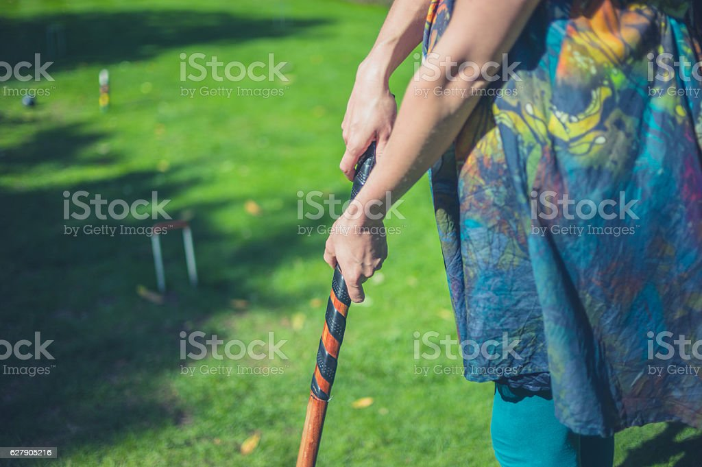 Young woman playing croquet stock photo