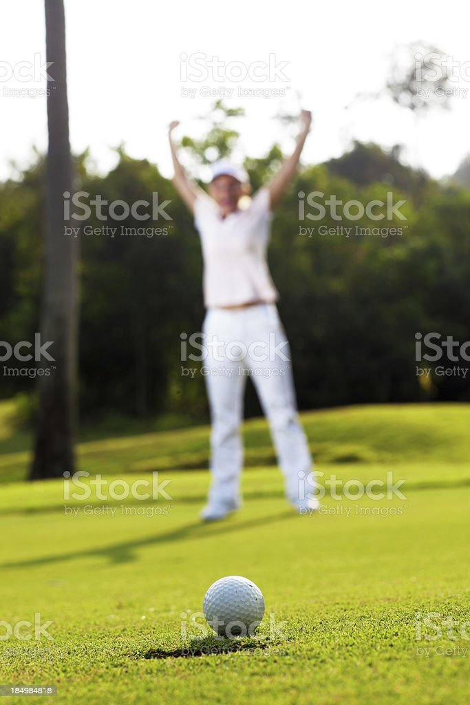 Young woman playing golf. royalty-free stock photo