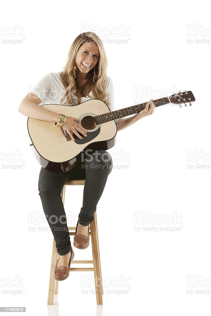 Young woman playing guitar stock photo