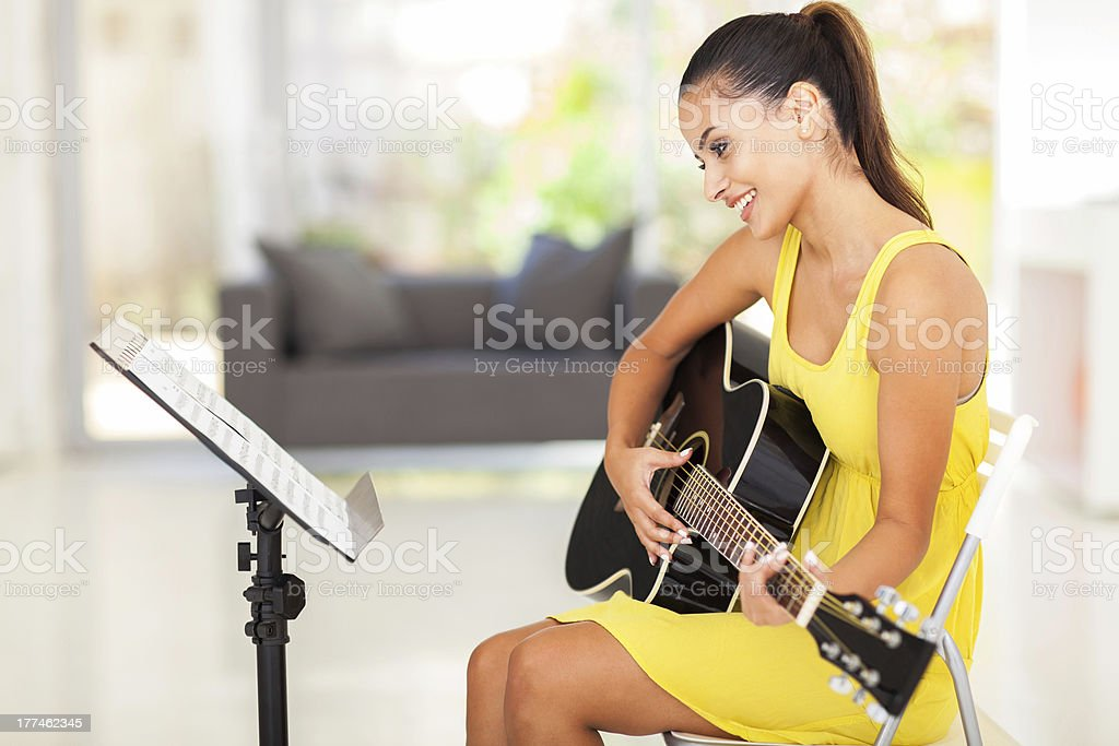 young woman playing guitar royalty-free stock photo