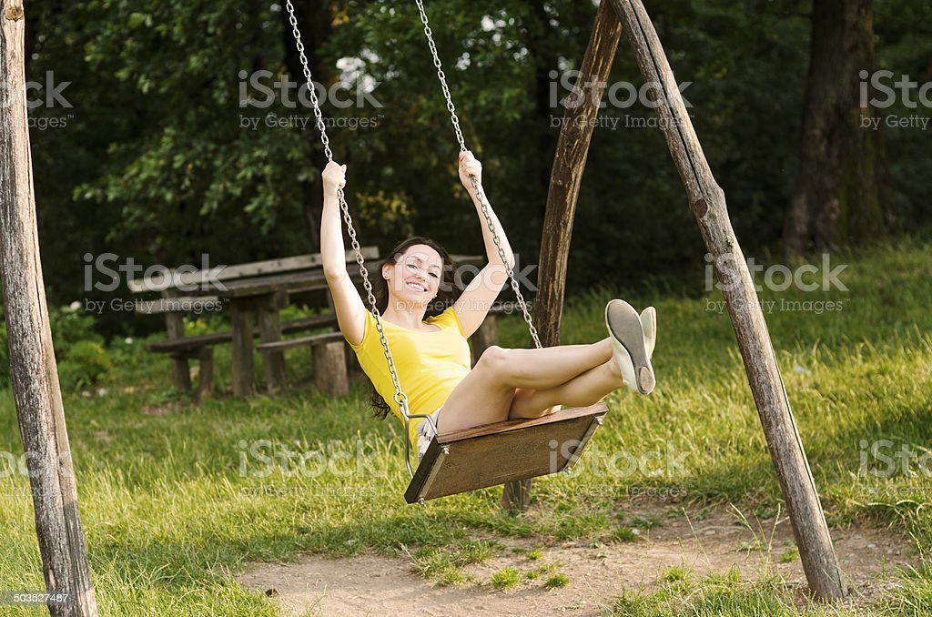 Young Woman Playing on a Swing royalty-free stock photo