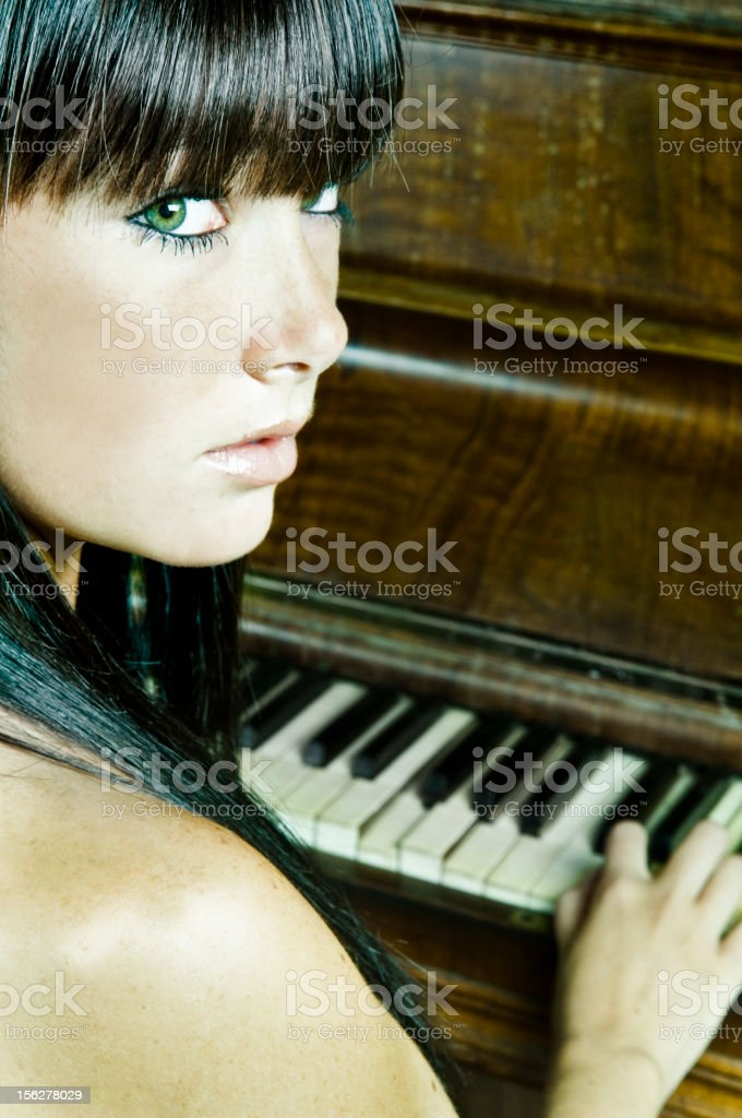Young Woman Playing Piano royalty-free stock photo