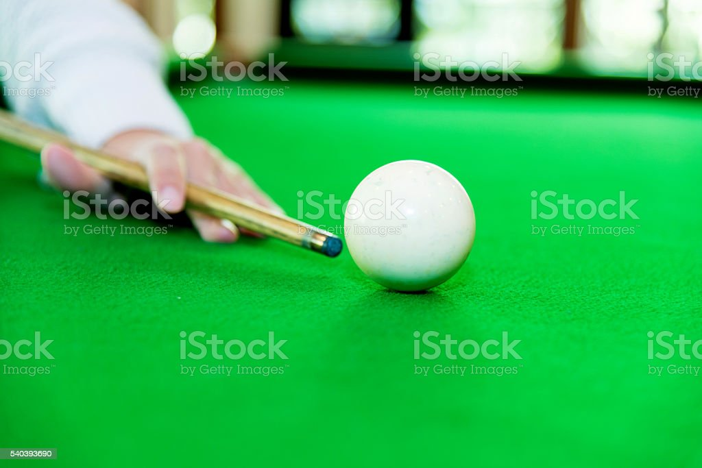 Young woman playing pool stock photo
