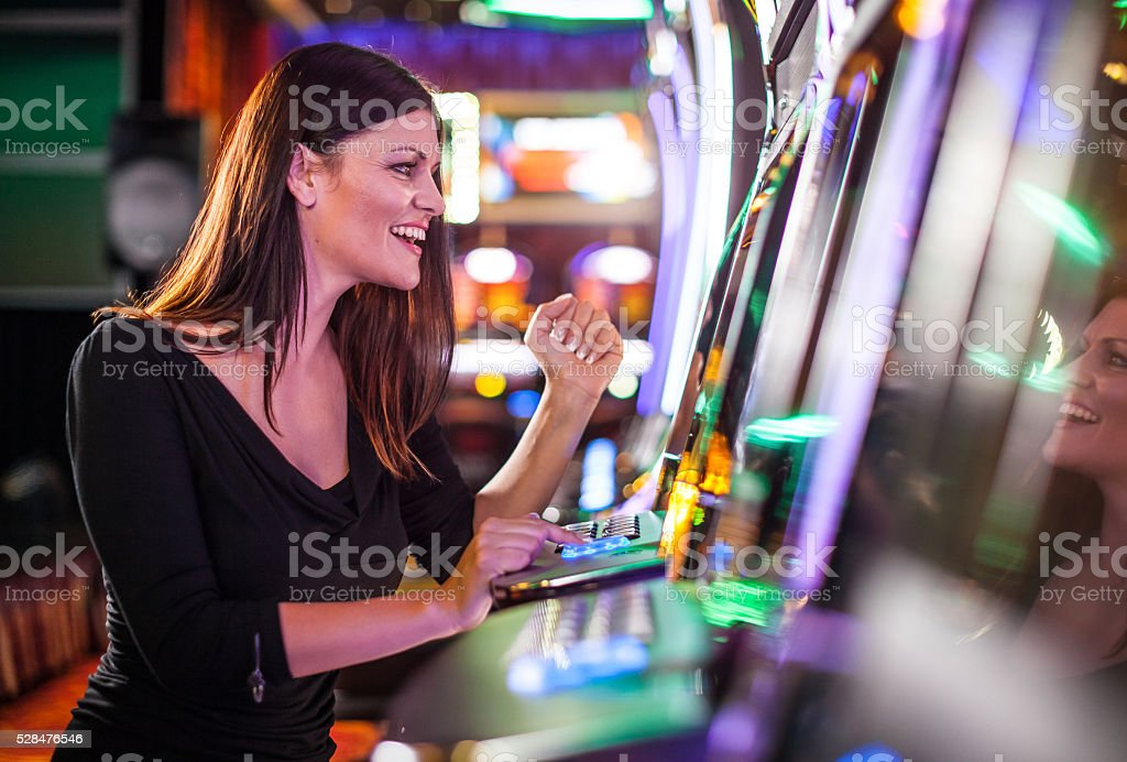 Young woman playing slot machines at the Casino stock photo