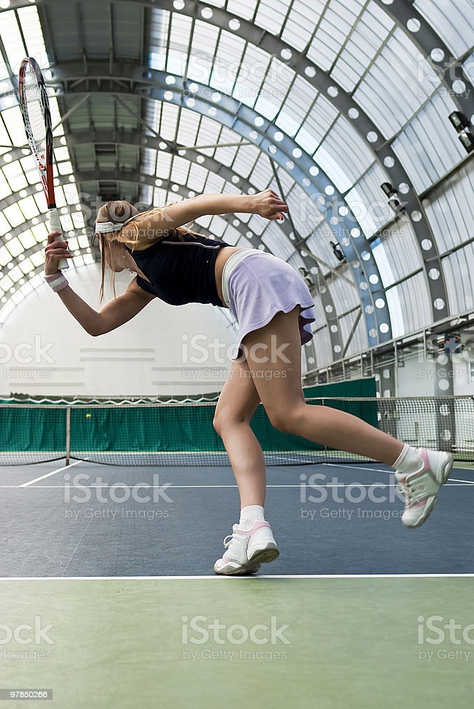 young woman playing tennis royalty-free stock photo