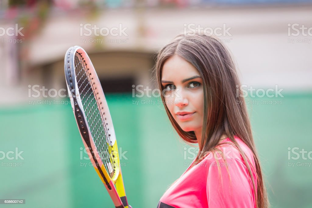 Young woman playing tennis,preparing for service stock photo