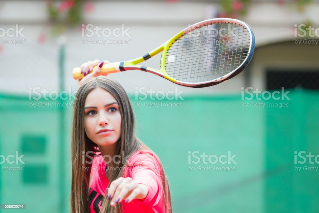 Young woman playing tennis,waiting the ball stock photo