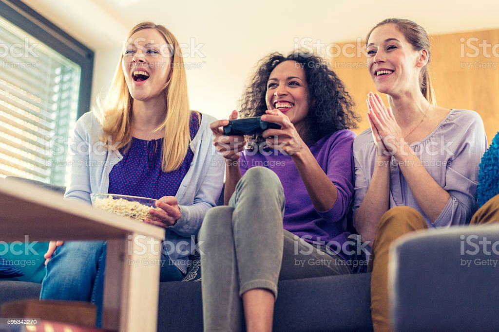 Young woman playing video game stock photo