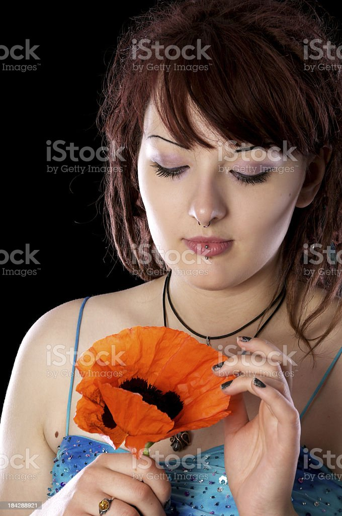 Young woman playing with big poppy. royalty-free stock photo