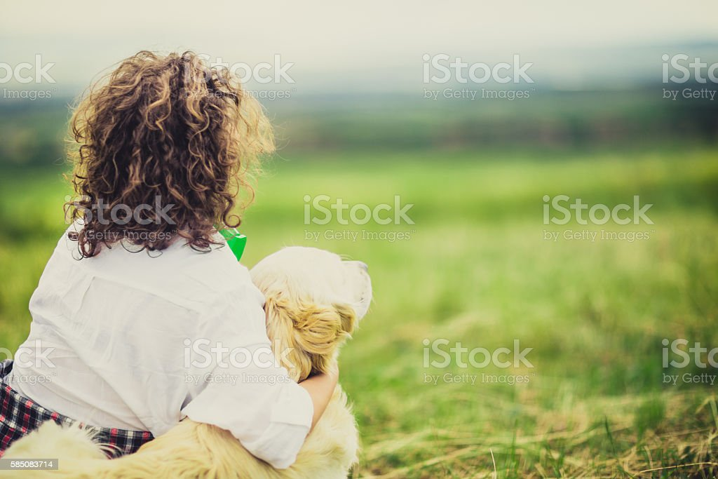 Young woman playing with dog stock photo