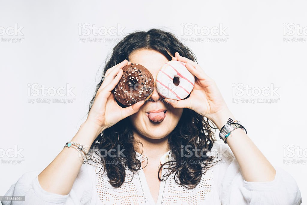Young Woman Playing With Donuts stock photo