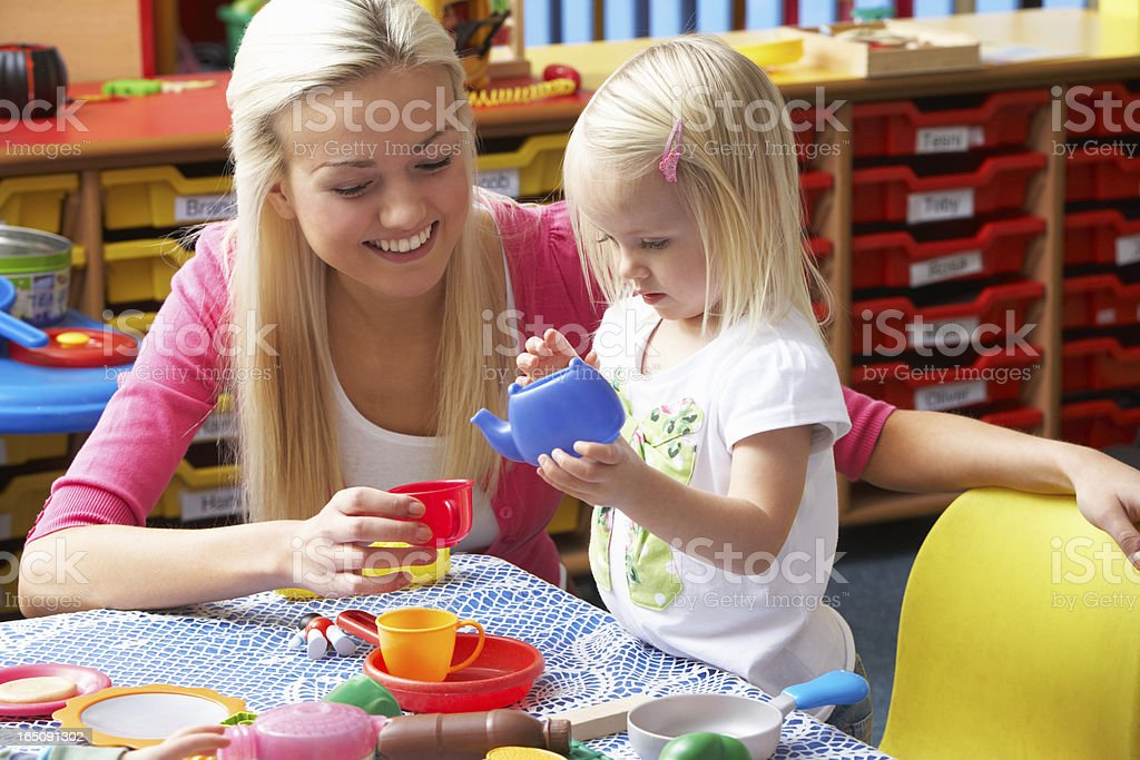 Young woman playing with girl stock photo