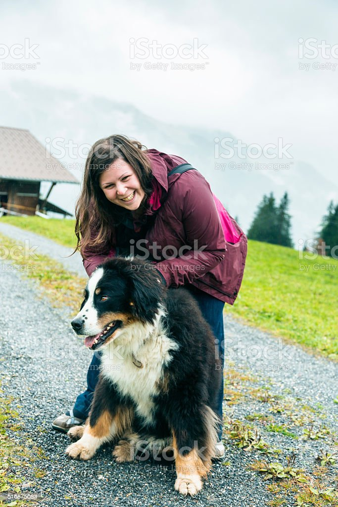 young woman playing with her dog stock photo