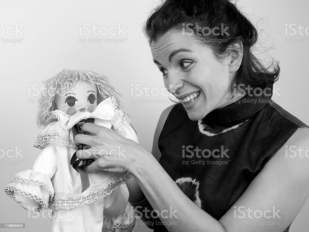 Young Woman Playing with Puppet royalty-free stock photo