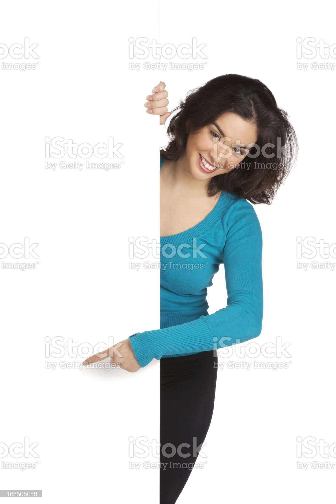 Young Woman Pointing Around a Blank Wall - Isolated royalty-free stock photo