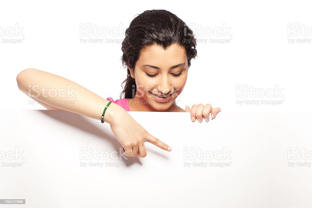 Young woman pointing at blank sheet royalty-free stock photo