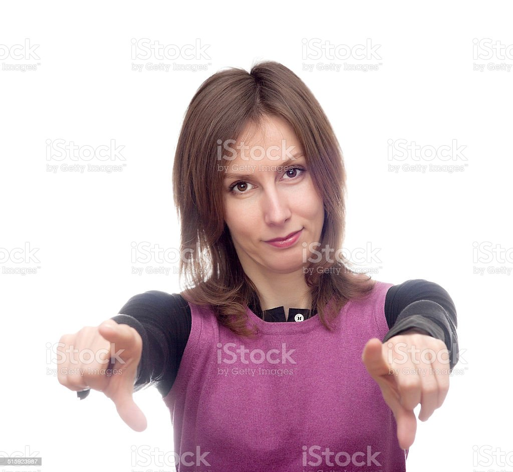 Young woman pointing both hands towards stock photo