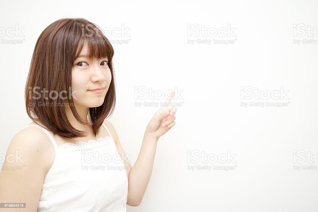 Young woman pointing something stock photo