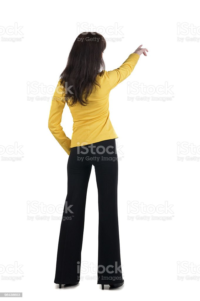 Young woman points at wall. royalty-free stock photo