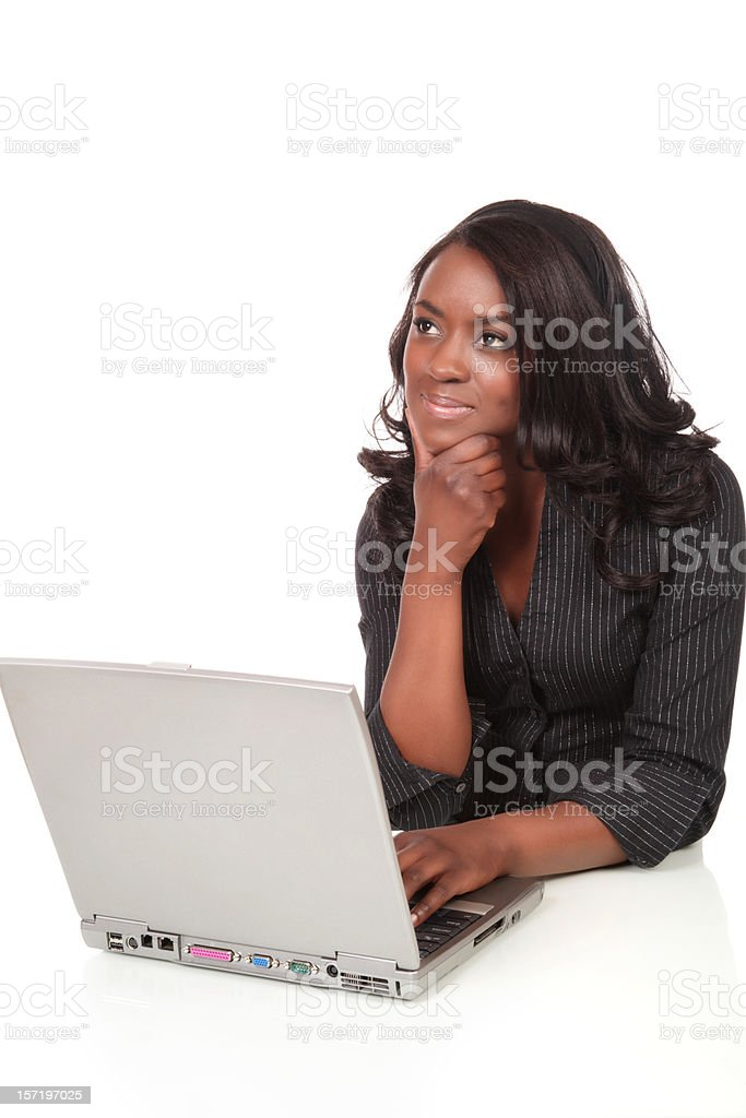 Young Woman Pondering Work stock photo