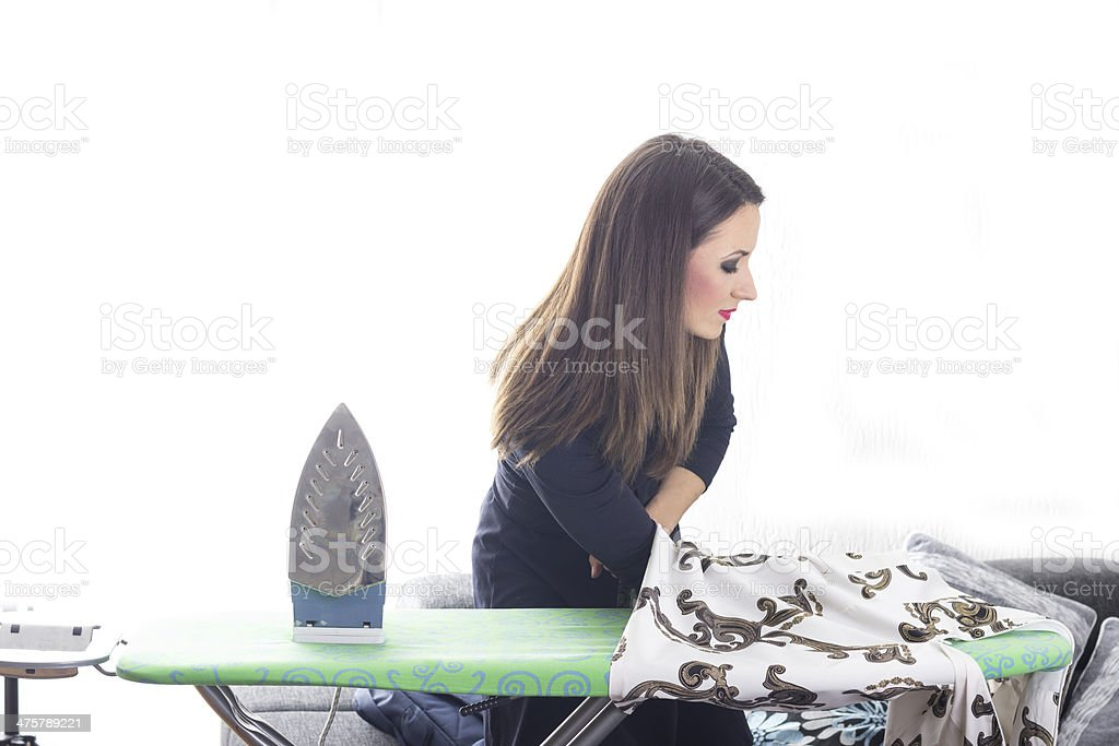 Young woman portrait after ironing stock photo
