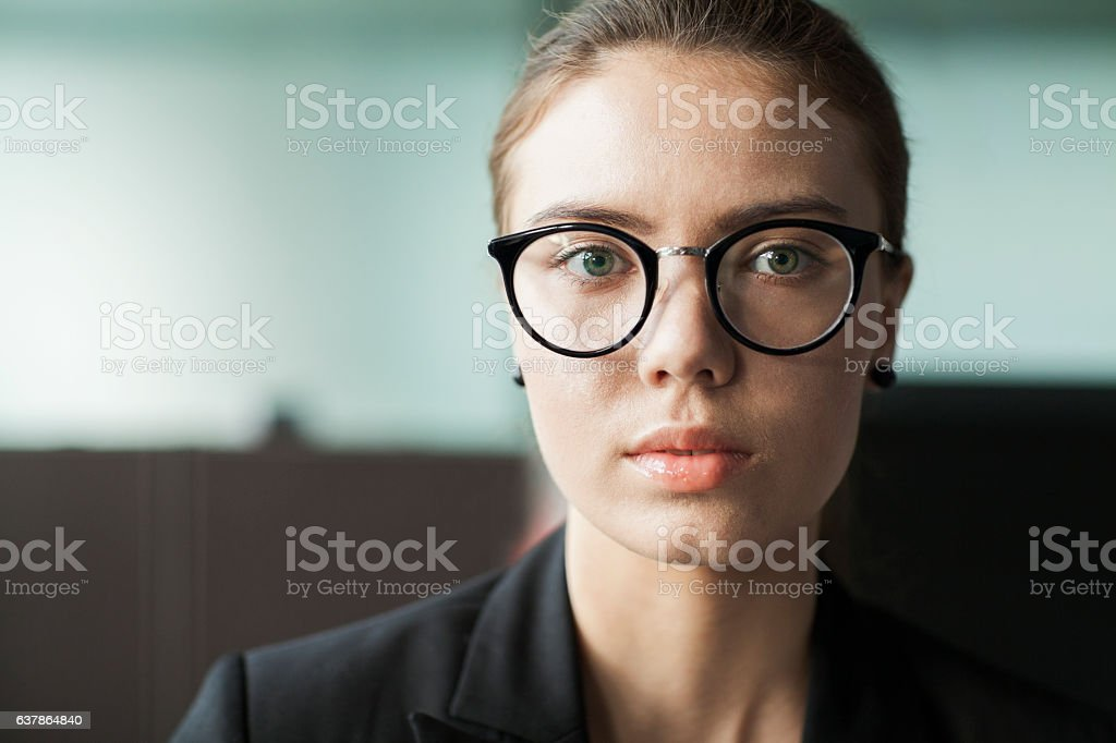 Young woman portrait in business office stock photo