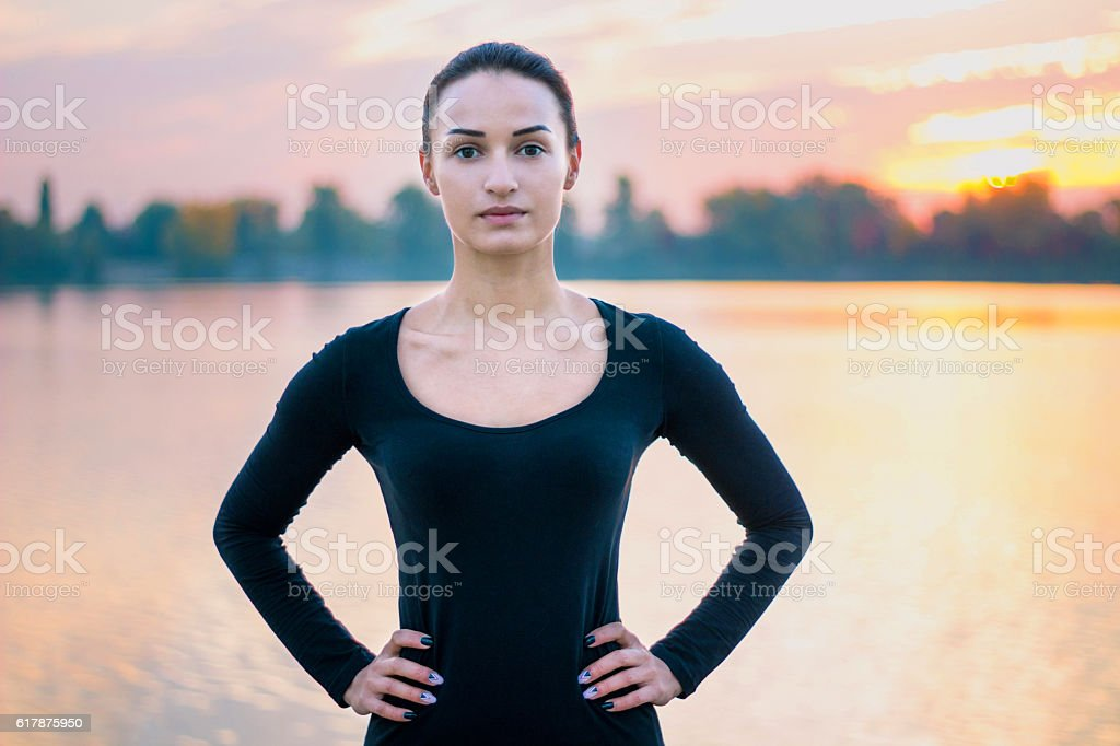 Young woman portrait in morning at sunrise background stock photo